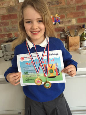 Girl with her 30 Day Challenge medals and certificate